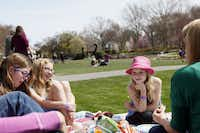 Alexis Dwyer, 8, Isabella Kelley, 9, and Lilly Kelley, 7, sit with their mothers during a picnic in the Jonsson Color Garden during the Dallas Blooms floral festival, on Wednesday, March 19, 2014 at the Dallas Arboretum in Dallas.Ben Torres - Special Contributor