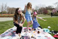 Alexis Dwyer, 8, Isabella Kelley, 9, and Lilly Kelley, 7, excitedly stand up for a game of tag during a picnic in the Jonsson Color Garden at the Dallas Blooms floral festival, on Wednesday, March 19, 2014 at the Dallas Arboretum in Dallas.Ben Torres - Special Contributor
