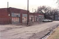 """Dale Wootton says that in 1991, when he bought the retail strip on Junius Street, """"the roof was falling in and the park was basically occupied by druggies."""""""