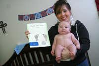Victoria Greene and her son Brantley Smith display a keepsake chart from his birth at Baylor Medical Center at Garland. Brantley, who was born in October 2013, is among the last babies to be delivered at Baylor Medical Center at Garland, which plans to close down its labor and delivery unit in April.( Photo by RUTH HAESEMEYER )