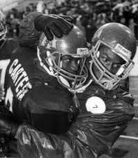 Gary Edwards (left) and LeShai Maston celebrate Dallas Carter's UIL Class 5A semifinal win over Odessa Permian on Dec. 10, 1988. (File 1988/The Associated Press)