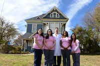 Staff (from left) Misty Vaughan, Carmen Benish, Dr. Jeremy Vaughan, Maria Aviles and Selenda Morales stand outside the Cedar Hill Women's Center, also known as the Gingerbread House on Dec. 3, 2013. The home, built in 1884, is the city's oldest structure. Residents will have the opportunity to tour the home, which holds a state historical marker and is on the National Register of Historic Places, from 2 to 6 p.m. Dec. 14 during the Cedar Hill Holiday Tour of Homes. (Rose Baca / neigborsgo staff photographer)ROSE BACA/neighborsgo staff photographer