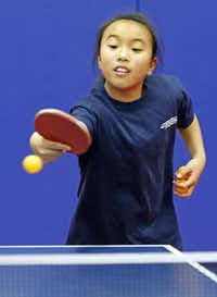 Katie Gao, 10, practiced her backhand during a recent pingpong session at Hua Yi Education in Plano.