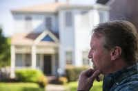 Henry S. Miller CEO Greg Miller stands outside the home of Ruth Sanders after a negotiation. (Smiley N. Pool/The Dallas Morning News)