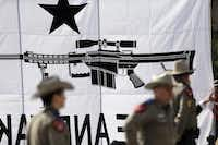 State troopers were on hand to watch over a rally staged by open carry supporters at the state Capitol in Austin on Monday.( Eric Gay  -  The Associated Press )