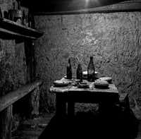 Dr. Jeff Gusky photographed this image Dec. 6, 2011. It shows French soldiers' dining area underground with wine bottles, canteens and a serving dish in Vauquois, France.( Photo by DR. JEFF GUSKY  - jeffgusky.com)
