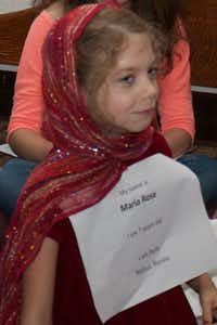 Isobel Roberts, a Sunday School student at Congregation Kol Ami in Flower Mound, dressed as a European Jewish refugee from the early 1900s for a lesson related to Hanukkah and Thanksgiving coinciding this year.