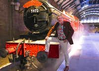 Mark Williams, who played Mr. Weasley in the Harry Potter films, poses with the Hogwarts Express on a recreated Platform 9 3/4 at Warner Bros. Studio Tours London in Leavesden, England.  Mark Williams, who played Mr. Weasley in the Harry Potter films, poses with the Hogwarts Express on a recreated Platform 9 3/4 at Warner Bros. Studio Tours London in Leavesden, England.(Amy Laughinghouse)