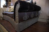 This sofa shows the Donna Moss touch with luxe fabrics (including faux leopard) and embellishments.