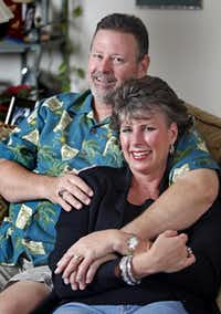 M.L. Dubay (right), 47, of Plano, and her husband Duane, 52, at their home in Plano on Tuesday, March 6, 2012. M.L. feels humor was an important part of her treatment.