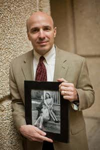 Dr. Stephen Skapek, medical director of Children's Medical Center for Cancer and Blood Disorders and director of UT Southwestern Medical Center's hematology and oncology division. Skapek is holding a picture of his three kids that tries to spend as much time with as possible.
