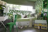 In this image provided by Brian Patrick Flynn, the bedroom of a tween cheerleader, designed by Brian Patrick Flynn, shows his use of the kelly green fabric of her cheerleading camp uniform as inspiration in Los Angeles. The green-covered space not only reminds her of cheerleading, but also wide open, green spaces.