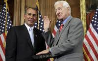 House Speaker John Boehner of Ohio participated in a ceremonial swearing-in with Rep. Ralph Hall in January 2011.