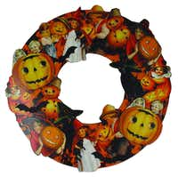 Ring of magic A three-dimensional, die-cut wreath of decoupage on wood with layered cutouts illustrates smiling children and pumpkins enjoying Halloween. 19 inch in diameter. $42.95 at Peek in the Attic, Dallas
