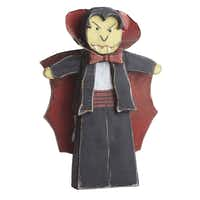 Vampire voodoo A quirky vampire of hand-painted, weathered wood with metal cape and collar protects yards from unexpected monsters. 30 inches high. $29.40 on sale at wisteria.com