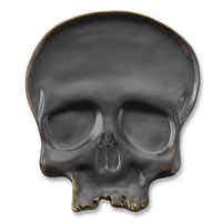 Black magic Little monsters will want to eat voodoo appetizers from these graphite gray, hand-cast stoneware skull plates. Microwavable and dishwasher safe. Set of four, $51.95 at williams-sonoma.com