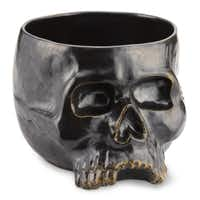 Abracadabra Magic potions can be served from this cranial punch bowl of hand-cast stoneware glazed in iridescent graphite gray. Holds 9 quarts of magic brew. $69.95 at williams-sonoma.com
