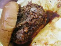 Wenzel's pork butt sandwich is one of the messiest barbecue experiences around - but worth it.June Naylor -  June Naylor