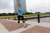LIsa Fritz, who works in the Las Colinas Urban Center, walks around Lake Carolyn.