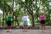 Members of the Flower Mound Walking Women group (from left) Susan Hayes, Kathie Greenwood and Shirley Morgan complete a yoga exercise in Glenwick Park in Flower Mound. The surrounding area was rated the the healthiest neighborhood in the Flower Mound and Lewisville area.