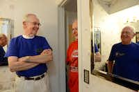 Plain-O Helpers Collins Baker (left) and Ed Sweeney (far right) chat with Plano resident Ron Johnson during a home repair visit to Johnson's home.