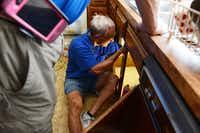 Plain-O Helper Irv Stone replaces the kitchen faucet at a Plano home.