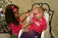 "Lily helps ""wake up"" Harper's mouth with a vibrating tool that helps stimulate her muscles."