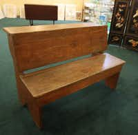 An antique school desk and seat