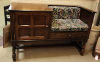 """A telephone cabinet with """"gossip seat"""""""
