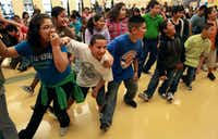 """From left: Beth Anderson Elementary School fifth-graders Yesenia Morales, Roberto Hernandez and Louis Enriguez joined fellow students in stretching during the """"Let's Move"""" anniversary event at the school in Arlington last month."""
