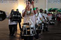 A drum line served as the prelude to the centennial parade Saturday night.