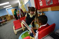 Kindergarteners Jagan Thomas (right) and Jacqueline Michael read books on the first day of school at Holy Trinity Catholic School.( Photo by ROSE BACA  - neighborsgo staff photographer)