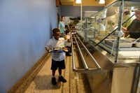 Sean Campbell gets lunch from the recently renovated kitchen on the first day of school.Photo by ROSE BACA  - neighborsgo staff photographer
