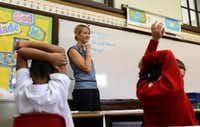 Second-grade teacher Susan Flusche makes a list of rules with her class on the first day of school at Holy Trinity Catholic School. The school, which has about 160 students, is celebrating its centennial year.Photos by ROSE BACA  - neighborsgo staff photographer
