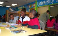 Eric Smith (left), A'nyah Peters and Ronald Clewis work on homework during the after-school program. Different organizations sponsored renovations in rooms of the club.Staff photo by ANANDA BOARDMAN