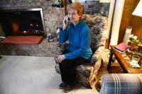 Sharon Keltner makes phone calls to a list of elderly, home-bound residents on Jan. 7, 2014. Keltner volunteers for the Duncanville Police Department's Call and Leave a Message program, which began more than three decades years ago to daily check on residents, mostly the elderly, who are home bound and live alone.ROSE BACA