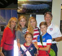 Clark Hunt (right), owner of FC Dallas, took his family to the World Cup in Brazil, continuing a family tradition started by his late father, Lamar.( Clark Hunt family )