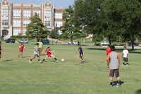 Ivy Frannea (center) lunges for the ball during the J.L. Long Buccaneer's first practice at Randall Park. The team, which is co-ed, allows fifth, sixth and seventh grade students to play fall and spring seasons of recreational soccer through the YMCA's league.( Staff photo by ANANDA BOARDMAN   -  neighborsgo )