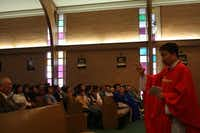 Fr. Vinh Trinh gives a sermon at Sunday mass at St. Peter Vietnamese Church.