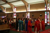 The congregation stands for the recessional at St. Peter Vietnamese Church after the Mass of the Feast of St. Peter on June 29.