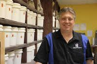 Brian Beyer manages the beer department at The Wine Maker's Toy Store and Dallas Home Brew. Behind him are specialty malts, which give beers their distinct flavors.