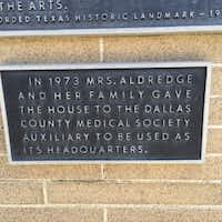 The plaque on the front of the Aldredge House notes that it was given to be used as a headquarters building.