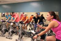 A cycling class shares stories while nearing the end of a workout at the J.E.R. Chilton YMCA at Rockwall. New locker rooms and a larger gym will arrive with a $5 million expansion project, which should break ground this month.Staff photo by CHRIS DERRETT