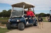 <TypographyTag11>Joan McDole</TypographyTag11>, widow of Robert McDole, drives the cart path while walking her dog at Duck Creek Golf Club. Robert McDole was the liaison for the course's property owner, HCB Real Holdings, after Oakridge Country Club went bankrupt in 2010.Staff photo by CHRIS DERRETT