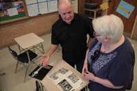 Bishop Lynch alumni John Ganter (left) and Joan Ellinger Bertucci share memories from Bishop Lynch yearbooks. President John F. Kennedy's assassination impacted both Ganter's and Bertucci's lives.Staff photos by CHRIS DERRETT