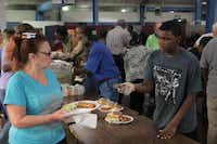 Riverside Missionary Baptist Church is one of many churches whose donations and volunteers allow Austin Street Center to operate without federal or state monies.(Staff photos by CHRIS DERRETT)