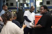 Members of Riverside Missionary Baptist church offer refreshments to those at Austin Street Center.(Staff photo by CHRIS DERRETT)