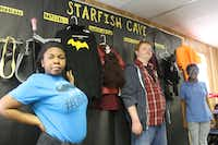 Shatequa Driver (left), John David Kinneman and Alandria Rivera stand by the costumes they put together for the Starfish Comic Expo. The Focus on the Future students have worked hard to create the comic convention, which will be held at Lewisville High School on Friday.( Staff photo by ADAM SCHRADER  -  neighborsgo )