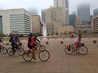 Bikers pedal to Dallas City Hall Wednesday.