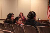 Elizabeth Morales (from left), Sydney Colon and Elisa Morales listen for information about Garland ISD's Translation & Interpretation Volunteer Community Outreach.( Staff photo by CHRIS DERRETT/neighborsgo )